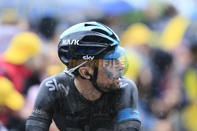 Bernhard Eisel (AUT) Team Sky crosses the finish line in Arenberg and looks up at the big screen to see a replay of team leader Chris Froome's crash at the end of a grueling Stage 5 of the 2014 Tour de France running 155.5km from Ypres to Arenberg. 9th July 2014.<br /> Picture: Eoin Clarke www.newsfile.ie