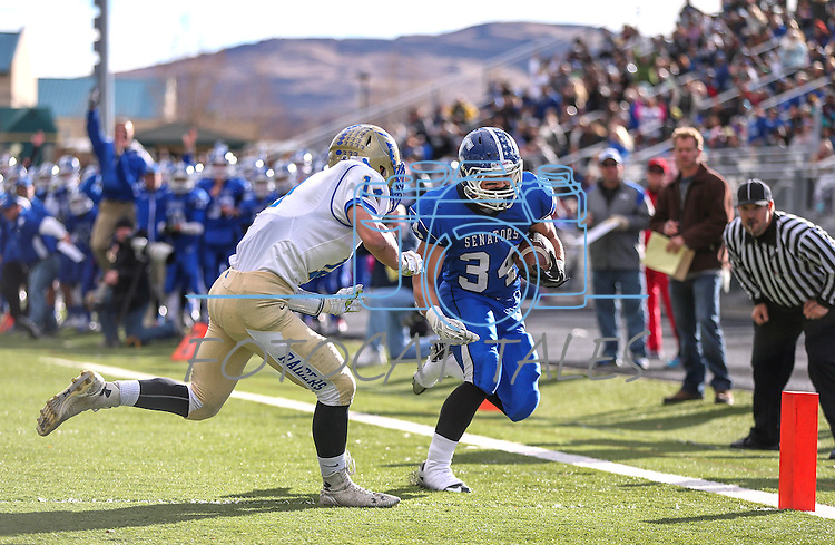Carson's Elijah Fajayan scores against Reed's Ty Warkentin during the NIAA D-1 Northern Regional title game at Bishop Manogue High School in Reno, Nev., on Saturday, Nov. 29, 2014. Reed won 28-25.<br /> Photo by Cathleen Allison