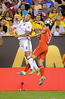 East Rutherford, NJ - Friday June 17, 2016: Edwin Cardona, Aldo Corzo after a Copa America Centenario quarterfinal match between Peru (PER) vs Colombia (COL) at MetLife Stadium.