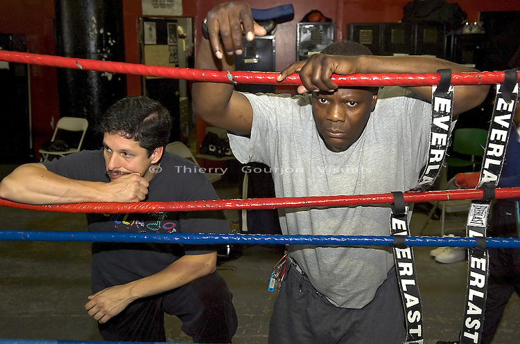 Trainer Harry Keitts (r) watching his fighter John Duddy shadow box at Gleason's Gym in Brooklyn, New York on 05.19.05  while training for his June Fight at MSG.