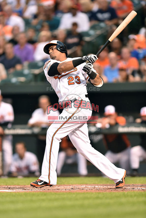 Baltimore Orioles designated hitter Nelson Cruz #23 swings at a pitch during a game against the New York Yankees at Oriole Park at Camden Yards August 11, 2014 in Baltimore, Maryland. The Orioles defeated the Yankees 11-3. (Tony Farlow/Four Seam Images)