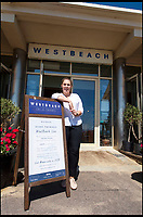 BNPS.co.uk (01202 558833)<br /> Pic: PhilYeomans/BNPS<br /> <br /> Delighted - West Beach restaurant manager Iga Sortuna 'Takings up 40 per cent on previous year.'<br /> <br /> The summer heatwave is leading to a 'bumper year' for tourism at Britain's premier seaside resort.<br /> <br /> Over 100,000 people are visiting Bournemouth, Dorset, every weekend and hotels are full to capacity, with restaurants packed and huge queues at ice cream stalls.<br /> <br /> Seafront kiosks are selling out of parasols and sun cream, while one bike hire company has reported a 50 per cent increase in business.