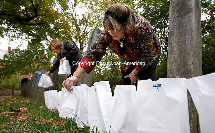 WATERBURY, CT. 24 October 2010-102410SV16--From left, Donna Gordon, supervisor counseling, and Tara Green, Director of the Hospice program, setup some of the more than 500 luminaries for hospice patients who have died at St. John&rsquo;s Church during the annual luminary service in Waterbury Sunday. Residents of Greater Waterbury were invited to remember their deceased loved ones at VNA HealthCare&rsquo;s Annual Luminary Remembrance Service. The event was Held in honor of National Hospice Month in November, the non-denominational service remembered community members and VNA HealthCare hospice patients who have passed away in the past year.<br /> Steven Valenti Republican-American