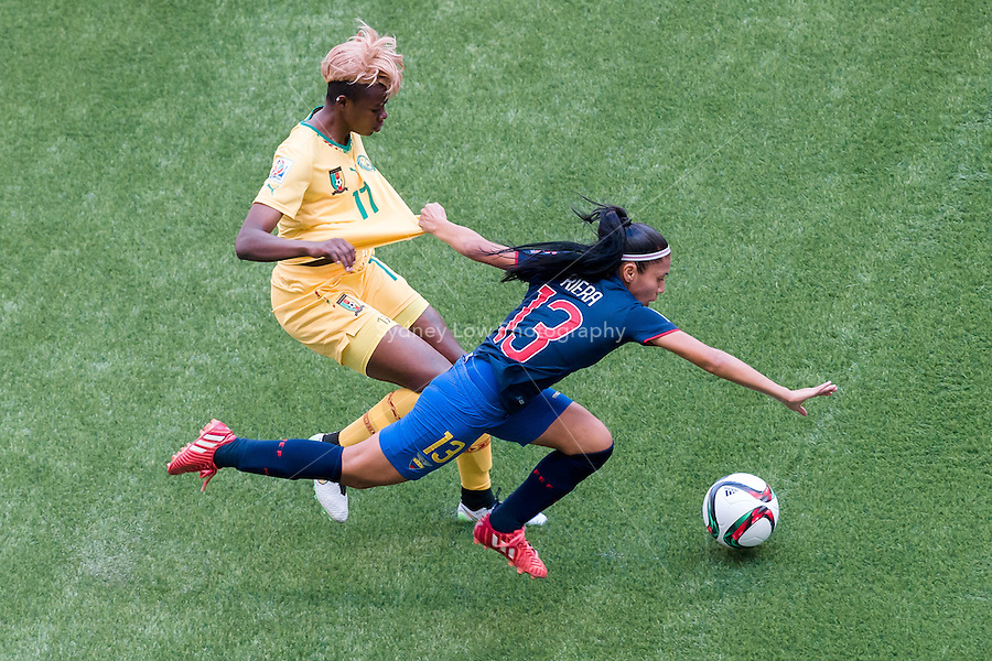 June 8, 2015: Gaelle ENGANAMOUIT of Cameroon and Madelin RIERA of Ecuador fights for the ball during a Group C match at the FIFA Women's World Cup Canada 2015 between Cameroon and Ecuador at BC Place Stadium on 8 June 2015 in Vancouver, Canada. Sydney Low/AsteriskImages