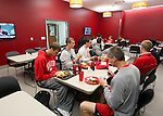 Wisconsin Badgers men's basketball team eat in the new dining room on move-in day at the LaBahn Arena Monday, October 1, 2012 in Madison, Wisc. (Photo by David Stluka)