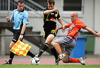 Waikato's Jason Chewins (right) tackles Andy Barron..NZFC soccer  - Team Wellington v Waikato FC at Newtown Park, Wellington. Sunday, 20 December 2009. Photo: Dave Lintott/lintottphoto.co.nz