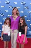 LOS ANGELES, CA - MAY 25:  Lori Loughlin at Fox's 'American Idol' season 10 finale results show held at Nokia Theatre LA Live on May 25, 2011 in Los Angeles, California.<br />  <br /> People:   Lori Loughlin Credit: Hoo-Me.com / MediaPunch