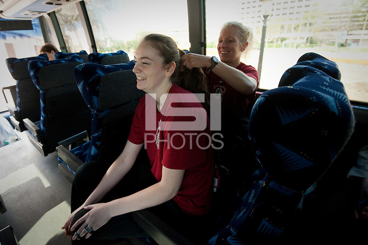 NORFOLK, VA--Bonnie Samuelson has her hair braided by Strength Coach Susan Borchardt before heading to the first round matchup against Hampton University at the Ted Constant Convocation Center at Old Dominion University in Norfolk, VA for the 2012 NCAA Championships.