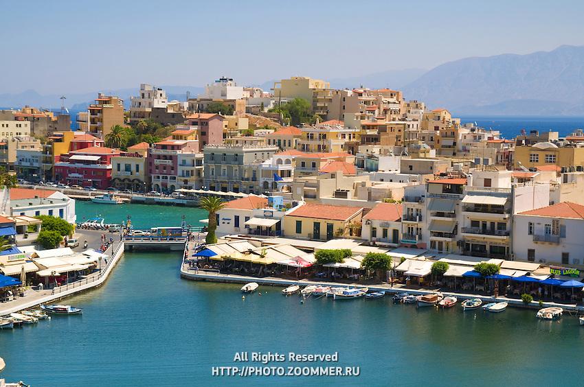 Lake Voulismeni with bridge and houses in Agios Nikolaos, Crete