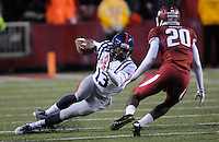 NWA Media/ J.T. Wampler -Ole Miss' Eugene Brazley looses his footing while trying to get by Arkansas' De'Andre Coley Saturday Nov. 22, 2014.