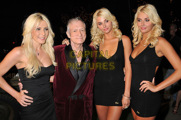 CRYSTAL HARRIS, HUGH HEFNER, KARISSA SHANNON & KRISTINA SHANNON.Stars and Stripes: An Evening of Sexy Patriotism Benefiting the Wounded Warrior Project held at the Playboy Mansion, Beverly Hills, CA, USA..may 16th, 2009.half length black dress maroon burgundy bathrobe cleavage hand on hip.CAP/ADM/BP.©Byron Purvis/AdMedia/Capital Pictures.
