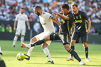 Landover, MD - August 4, 2018: Real Madrid forward Karim Benzema (9) holds off a Juventus defender during the match between Juventus and Real Madrid at FedEx Field in Landover, MD.   (Photo by Elliott Brown/Media Images International)