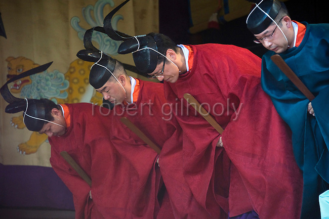Shrine priests bow during a ritual in the inner sanctuary of the main hall on the second day of the 3-day Reitaisai grand festival at Tsurugaoka Hachimangu shrine in Kamakura, Japan on  15 Sept. 2012.  Photographer: Robert Gilhooly