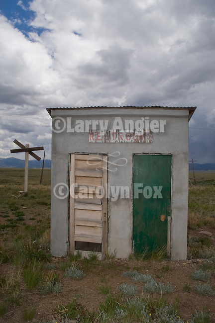 Railroad trackside two-door outhouse, clouds, Como, Colorado