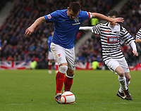 Lee McCulloch holds off Andrew Robertson in the Queen's Park v Rangers Irn-Bru Scottish League Division Three match played at Hampden Park, Glasgow on 29.12.12.