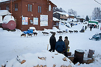 Rick Swenson leaves Takotna while volunteers man the hot water pot during Iditarod 2009