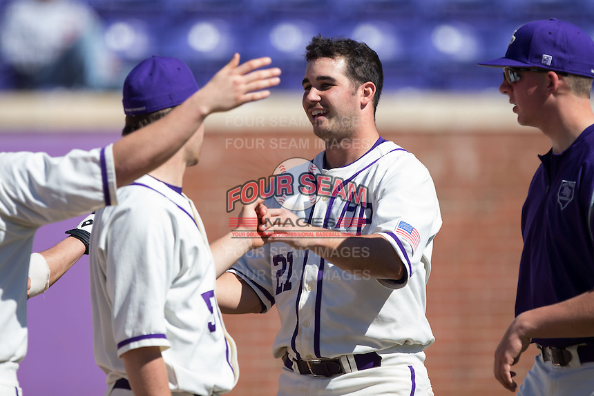 Josh Spano (21) of the High Point Panthers is congratulated by his teammates after scoring a run against the LIU-Brooklyn Blackbirds at Willard Stadium on March 8, 2015 in High Point, North Carolina.  The Panthers defeated the Blackbirds 9-0.  (Brian Westerholt/Four Seam Images)