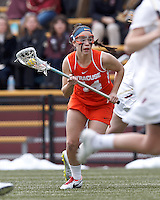 Syracuse University attacker Devon Collins (44) brings the ball forward.   Syracuse University (orange) defeated Boston College (white), 17-12, on the Newton Campus Lacrosse Field at Boston College, on March 27, 2013.