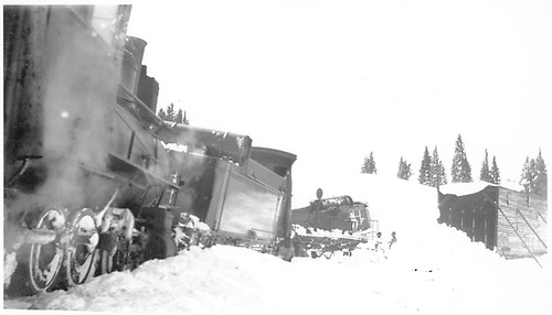 At least three D&amp;RGW locomotives and a flanger are derailed and in a mess near the Cumbres snowshed.<br /> D&amp;RGW  Cumbres, CO