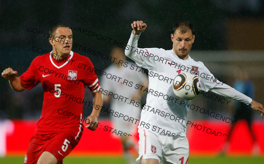Fudbal, World Cup 2010, preparations.Austria international test match.Serbia Vs. Poland, friendly match, .Milan Jovanovic, right is challanged by Poland player Barivsz Dudka.Kufstein, 02.06.2010..foto: Srdjan Stevanovic/Starsportphoto ©