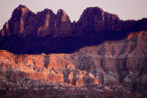 Clay beds provide the foreground for Smithsonian Butte at sunset near Zion National Park, Utah