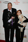 HOLLYWOOD, CA. - October 03: Ken Howard, wife Linda and dogs arrive at the Best Friends Animal Society's 2009 Lint Roller Party at the Hollywood Palladium on October 3, 2009 in Hollywood, California.