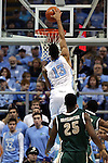 27 December 2014: North Carolina's J.P. Tokoto (13) dunks the ball. The University of North Carolina Tar Heels played the University of Alabama Birmingham Blazers in an NCAA Division I Men's basketball game at the Dean E. Smith Center in Chapel Hill, North Carolina. UNC won the game 89-58.