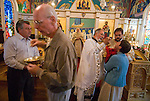 Liturgy service at St. Sava Orthodox Church, Jackson, Calif...Father Stephen Tumbas  assisted by Dan Stojanovich present the sacrament to the prepared faithful at the end of the worship service as the Very Reverend Miladin Garich watches from behind.