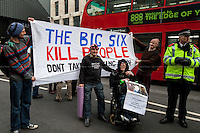 """London, 28/11/2014. Today, """"Fuel Poverty Action"""" and """"Reclaim The Power"""" held a demonstration outside Energy UK office in central London, while David Cameron's Government was reveleang to the public how many people died last year from the effects of fuel poverty. From the organisers Facebook event page:"""