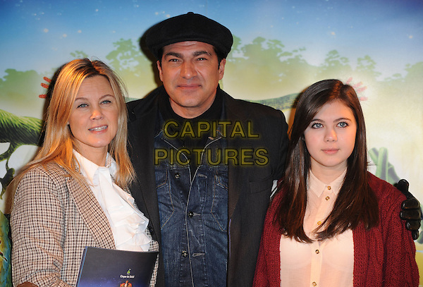 wife & Tamer Hassan & guest.'Cirque Du Soleil: Totem' UK Premiere, Royal Albert Hall, London, England..5th January 2012.half length blue jacket beige elbow patches tweed black hat cap married husband pink red.CAP/WIZ.© Wizard/Capital Pictures.