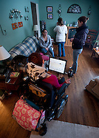 Healthcare advocate Kara Vander Veer at home where she lives independantly with the help of personal assistants. Kara is a healthcare advocate for the non-profit organization Arise  where she works to help people with disabilities obtain healthcare and make the transition to independant living. Photo by James R. Evans©