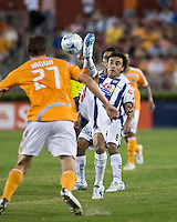 Pachuca FC defender Leobardo Lopez (2) deflects the ball away from Houston Dynamo forward Nate Jaqua (27).  Houston Dynamo defeated Pachuca FC 2-0 in the semifinals of the Superliga 2008 tournament at Robertson Stadium in Houston, TX on July 29, 2008.