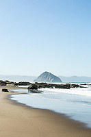 Highway 1 runs past the beach north of Morro Rock. Morro Bay, California.