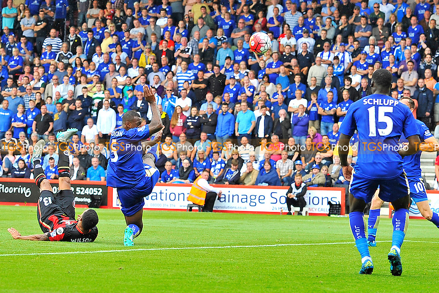 Callum Wilson of AFC Bournemouth left fires in an overhead kick past Wes Morgan of Leicester City to score the first goal during AFC Bournemouth vs Leicester City