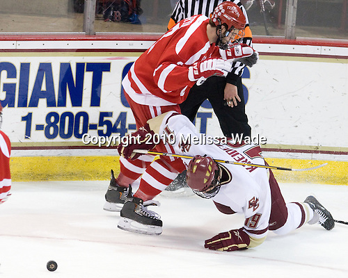 Eric Gryba (BU - 2), Chris Kreider (BC - 19) - The Boston University Terriers defeated the Boston College Eagles 5-4 (OT) on Friday, January 22, 2010, at Conte Forum in Chestnut Hill, Massachusetts.