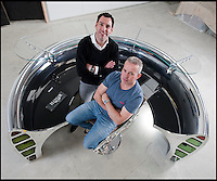 BNPS.co.uk (01202 558833)<br /> Pic: PhilYeomans/BNPS<br /> <br /> Bespoke furniture for the Jet Set.<br /> <br /> Brett and Shane Armstrong at a &pound;20,000 reception desk made from a 737 engine intake.<br /> <br /> Two brother's have come up with ultimate in aircraft recycling - turning unwanted bits of redundant airliners into highly desirable - and highly expensive - bespoke items of furniture.<br /> <br /> Brett and Shane Armstrong from Kent scour the worlds aircraft graveyards looking for interesting items they can rescue from sad decay and with a lot of imagination and elbow grease convert into one-off gleaming items of furniture costing thousands of pounds.
