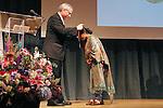 Jeremy Travis presents award to Sunitha Krishnan, at the John Jay Justice Award ceremony, April 5 2011.