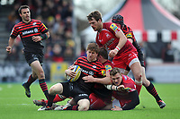 David Strettle is tackled to ground. Aviva Premiership match, between Saracens and London Welsh on March 3, 2013 at Allianz Park in London, England. Photo by: Patrick Khachfe / Onside Images