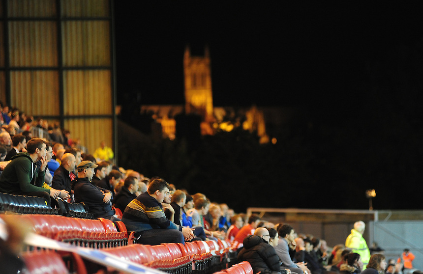 A general view of The Gelder Group Sincil Bank Stadium home of Lincoln City during their game against Tamworth, as Lincoln Cathedral provides a backdrop for the fans<br /> <br /> (Photo by Chris Vaughan/CameraSport)<br /> <br /> Football - The Skrill Premier - Lincoln City v Tamworth - Tuesady 8th October 2013 - Gelder Group Sincil Bank Stadium - Lincoln<br /> <br /> &copy; CameraSport - 43 Linden Ave. Countesthorpe. Leicester. England. LE8 5PG - Tel: +44 (0) 116 277 4147 - admin@camerasport.com - www.camerasport.com