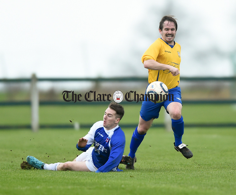 Daryl Eade of Clare in action against Johnathan Hannafin of Limerick during their FAI Oscar Traynor game in Limerick. Photograph by John Kelly.