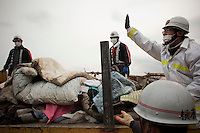 Rescue workers pile bodies onto the back of a truck. Thousands of people died in this small town which ran out of body bags. On 11 March 2011 a magnitude 9 earthquake struck 130 km off the coast of Northern Japan causing a massive Tsunami that swept across the coast of Northern Honshu. The earthquake and tsunami caused extensive damage and loss of life.
