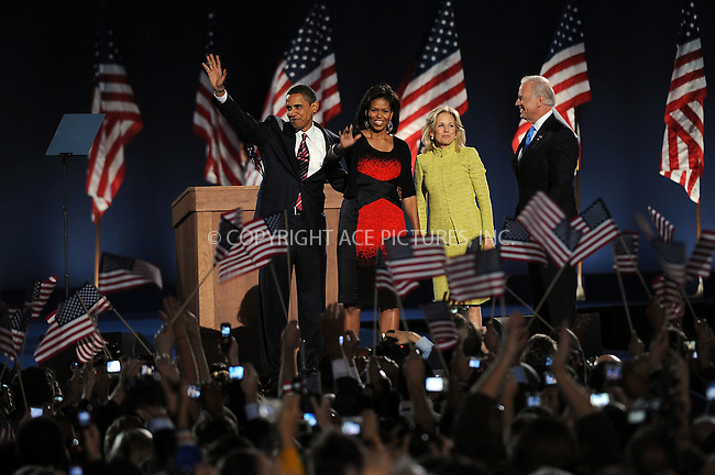 WWW.ACEPIXS.COM . . . . . ....November 4 2008, Chicago....U.S. President elect Barack Obama (L) and his wife Michelle (2nd L) wave to their supporters along with Vice-President elect Joe Biden (right) and his wife Jill at a rally in Grant Park as it became clear that he had been elected to the position of President of the United States of America on November 4 2008 in Chicago, IL....Please byline: KRISTIN CALLAHAN - ACEPIXS.COM.. . . . . . ..Ace Pictures, Inc:  ..(212) 243-8787 or (646) 679 0430..e-mail: picturedesk@acepixs.com..web: http://www.acepixs.com