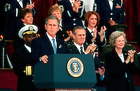 Oct 11, 2001, Washington, DC, United States<br /> <br /> President George W. Bush (L) gets a standing ovation during his address at the Pentagon memorial service on Oct. 11, 2001, in honor of those who perished in the terrorist attack on the building.   Bush, Secretary of Defense Donald H. Rumsfeld (R)  and Chairman of the Joint Chiefs of Staff Gen. Richard B. Myers, U.S. Air Force, eulogized the 184 persons killed when a terrorist hijacked airliner was purposely crashed into the southwest face of the building on Sept. 11, 2001. <br /> <br /> Mandatory Credit: Photo by DoD photo by Helene C. Stikkel.(Released)-