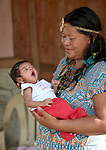 Anacelia Barros da Costa holds a grandchild in the Nacoes Indigenas neighborhood in Manaus, Brazil. The neighborhood is home to members of more than a dozen indigenous groups, many of whose members have migrated to the city in recent years from their homes in the Amazon forest.