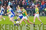 On the Run: John Griffin of Finuge making a break from the Castleisland Desmond's players