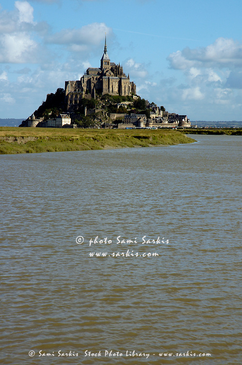 The Couesnon river in front of Mont Saint-Michel, a fortified medieval monastery on an island in Normandy, France.
