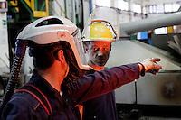 Arezzo: operai al alvoro all'interno dello stabilimento Chimet. L'azienda recupera metalli preziosi (oro, platino, palladio, iridio, argento) da materiali di scarto come catalizzatori di marmitte, batterie, contatti elettrici di cellulari, computer o materiali di scarto industriale.<br /> <br /> Arezzo: The Chimet company recovers precious metals (gold, platinum, palladium, iridium, silver) from waste materials such as catalysts, mufflers, batteries, electrical contacts to phones, computers or industrial waste materials.