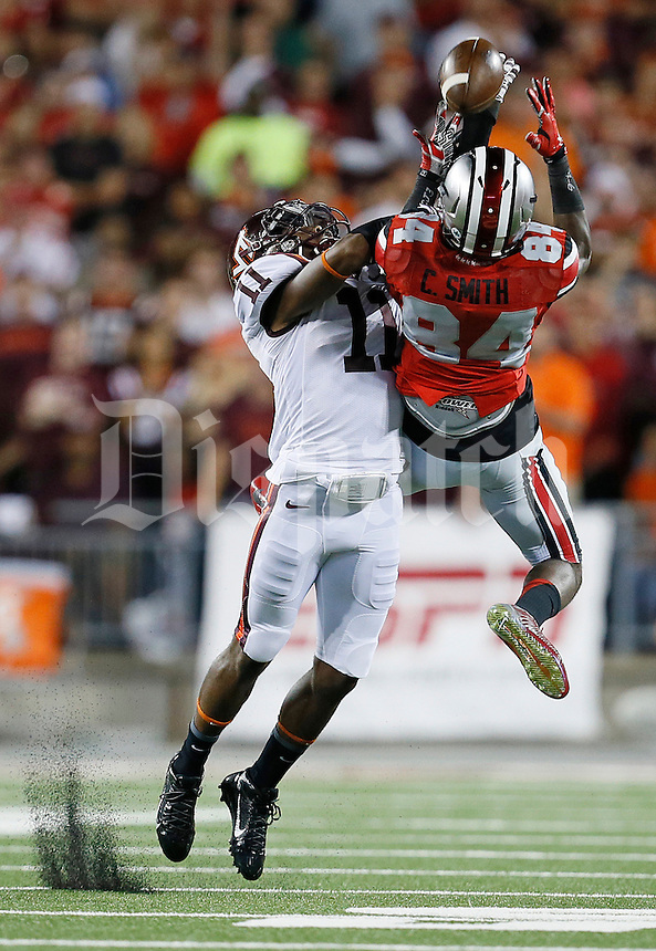 Ohio State Buckeyes wide receiver Corey Smith (84) fails to haul in a pass under pressure from Virginia Tech Hokies cornerback Kendall Fuller (11) in the first quarter of the college football game between the Ohio State Buckeyes and the Virginia Tech Hokies at Ohio Stadium in Columbus, Saturday afternoon, September 6, 2014. As of half time the Virginia Tech Hokies led the Ohio State Buckeyes 21 - 7. (The Columbus Dispatch / Eamon Queeney)