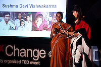Sushma Devi Vishwakarma (left) speaks on stage as Feroze Gujral translates for her at the India Islamic Cultural Centre during the TEDxChange @ TEDxDelhi in New Delhi, India on 22nd March 2011..