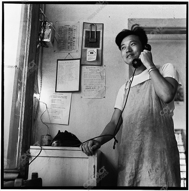 Li on the phone in his office at the Heilongjiang Daily in Harbin (photographed with a self-timer). 5 August 1975